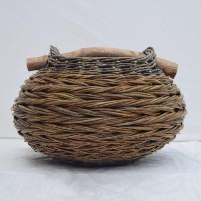 Bulbous herringbone woven reed basket by Sue Kirk